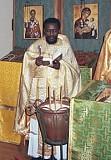 Fr. Christopher Walusimbi serves Liturgy in Beltsville, MD.